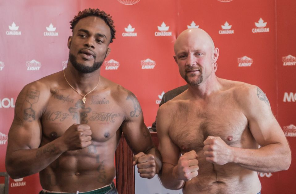 Brad Wilson, right, with his opponent Markhaile Wedderburn, who fought on   June 24.  Wedderburn won the fight after it was stopped in the second round. submitted