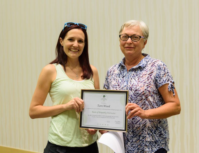 Terri Woods recieves her award for ten years of dedication with the Roots of Empathy program