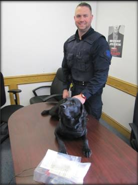 Correctional Officer Jeffrey Hood and his K-9 companion Cotton seized over $36,000 worth of contraband from the Drumheller institution on July 6, 2017.