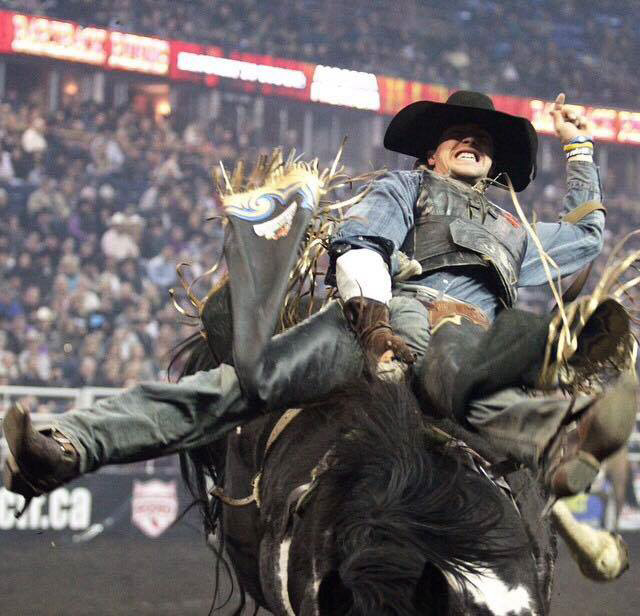 Goodine hangs on for dear life at a rodeo competition from earlier this year - Submitted photo