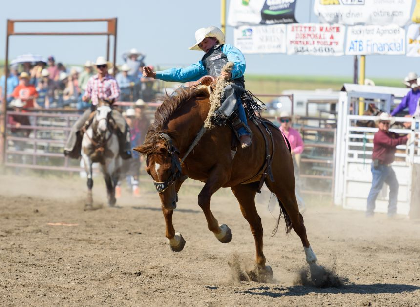 Chance Bohmer of Hillcrest, AB., left, rides Ned Pepper (91) in the Saddle Bronc portion of the 60th annual Rockyford Rodeo.