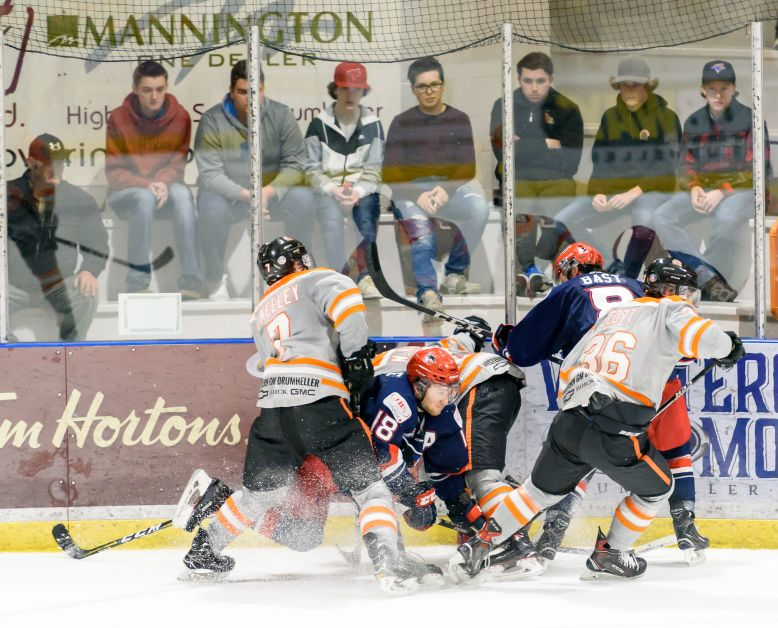 The Dragons and Bandits game did not end without many scrapping fights. Mailphoto by Terri Huxley